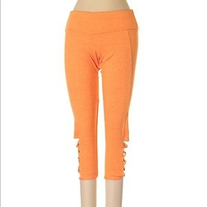 Orange cutout athleisure pants